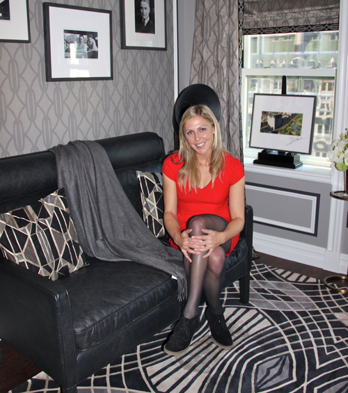 """Blake Hazard, the great-granddaughter of Zelda and Scott Fitzgerald, looks comfortable in The Fitzgerald Suite, sitting on the 52"""" Madsen Sofa, available at RH, Restoration Hardware."""