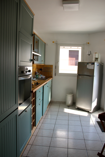 The kitchen in our Antibes rental faced the terrace. We didn't end up cooking but were glad to have a fridge and a drying rack for washing bottles.