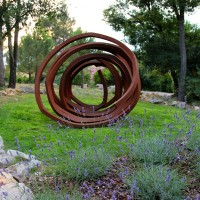 """Bernar Venet's """"Lignes Indeterminees"""" at Terre Blanche makes me think of Shakespeare's famous phrase """"shuffled off this mortal coil"""" from Hamlet's soliloquy. #provence #art #sculpture"""