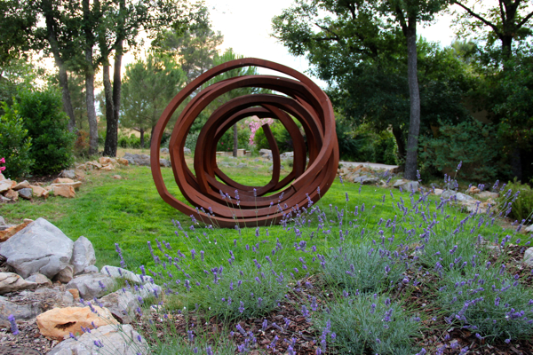 "Bernar Venet's ""Lignes Indeterminees"" at Terre Blanche makes me think of Shakespeare's famous phrase ""shuffled off this mortal coil"" from Hamlet's soliloquy. #provence #art #sculpture"