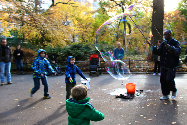 Stephen Duncan, The Central Park Bubble Man, captivates his audience. The kids know to stand back from these massive bubbles!