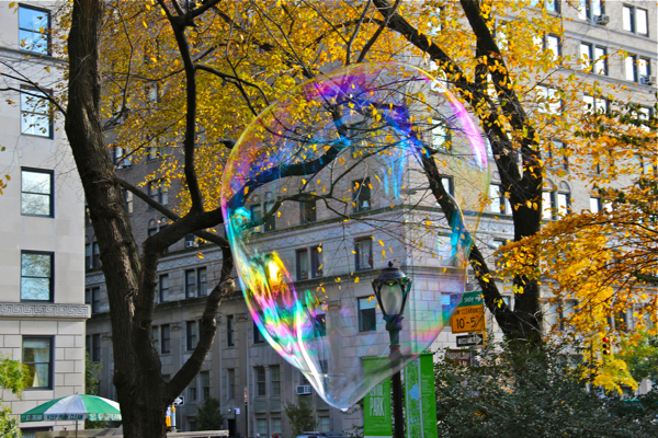One of The Bubble Man's bubbles leaves Central Park and floats off to Fifth Avenue. #bubbles #NYC #fallfoliage