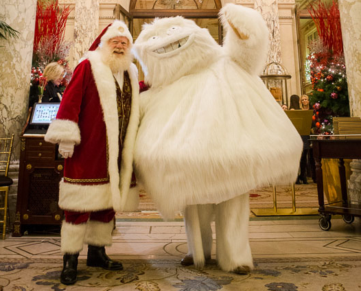 The Plaza Santa and the Saks Yeti bring Christmas cheer to the tree lighting at The Plaza.