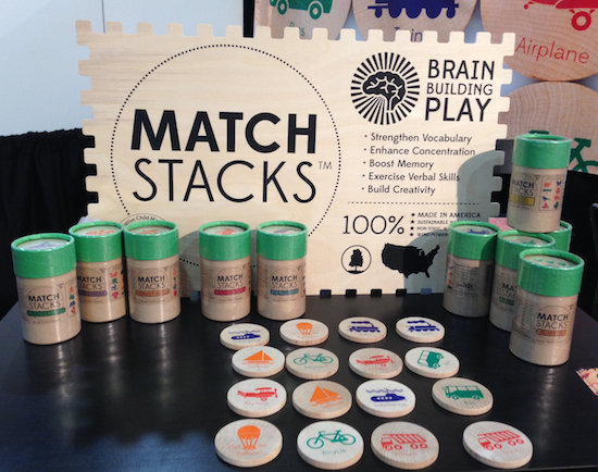 Match Stacks, a memory game of 16 wooden discs by Tree Hopper Toys, is packaged in a reusable tube. #ToyFair14