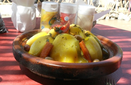 You'll find variations of chicken and preserved lemon tajine everywhere. Depending on what season it is it might be served with potatoes, olives, or even French fries on top. Photo by Amanda Mouttaki