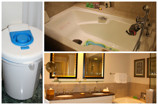 The fancy Four Seasons Washington bathroom goes baby-friendly: a diaper genie and a personalized bathtub with bath toys!